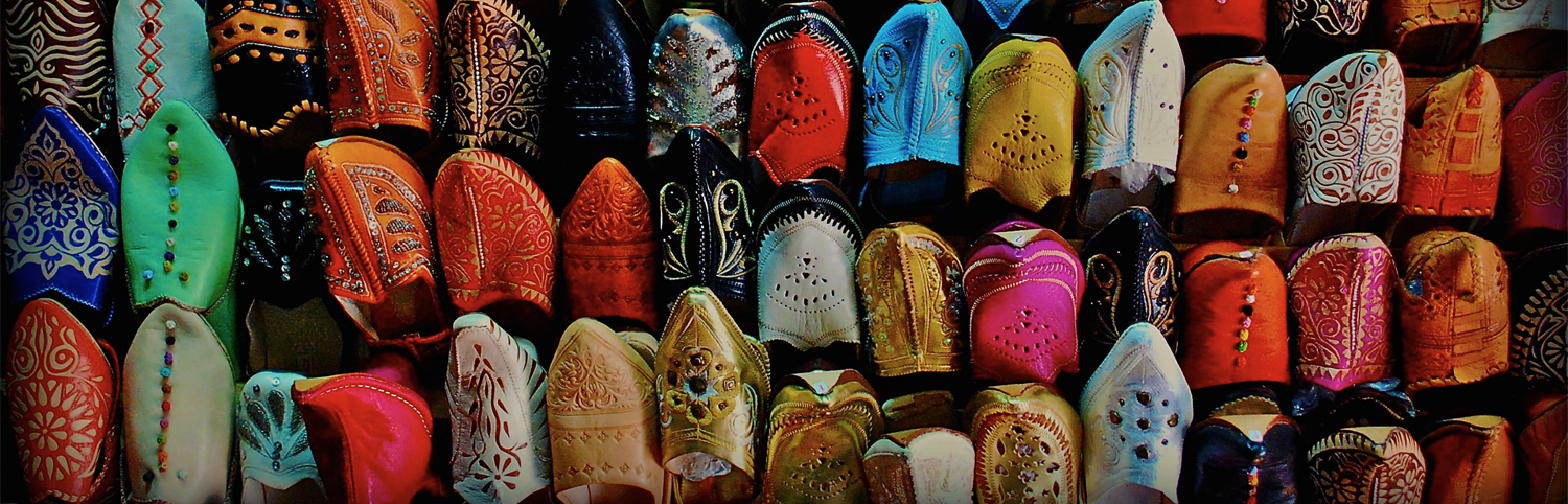 Hand crafted, colorful Morocco shoes on display in the market